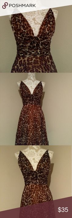 NWOT Leopard dress Breathtaking and classy, this soft and sensual dress with bottom flare is show stopping and versatile. Wear it to the concert or a formal affair. I wear a 4 but thought I could squeeze into it...I decided not to try, but I admire it daily. Dresses Midi