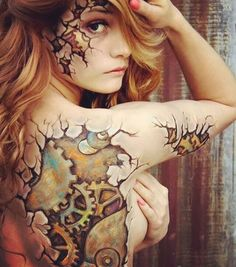 Cracked steampunk gears body paint... But wouldn't this be a bada$$ tattoo? - Saved from bodypaintmagazine.com #steampunk #gears #pinwheels #tatooidea #bodypaint