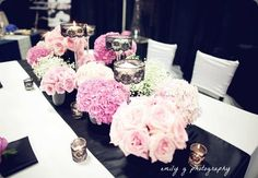 A deconstructed pink floral  centerpiece comprised of pink flower arrangements -  emily g photography and zest floral