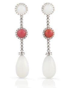 TARA Pearls Natural Conch Pearl Earrings set in Platinum with Diamonds.