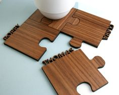 A set of four personalised, interlocking walnut jigsaw coasters. Bring some fun to your home with these beautifully personalised jigsaw shaped walnut cut out jigsaw coasters. The ingenious design is not only a set of four individual coasters but the jigsaw shaped pieces fit together perfectly illustrating unity and creating a beautiful centrepiece. Each original wooden coaster has a name or word of your choice cut along the edge. A fantastic family gift for a new home, mothers day, father...