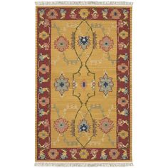 This classic border rug is hand-tufted in India from 100-percent New Zealand wool. It features a traditional pattern with an aged look that will bring instant elegance to your room.