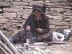 """support type spindle -- """"This is a Tibetan woman spinning wool by hand. She lives in Himalayan Mountains. This is a simple morning for this woman."""""""