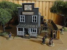 this undertakers has a yard large enough to accommodate a hearse and a collection of timbers for building coffins.