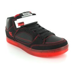 Red Soled Etnies skate shoes.