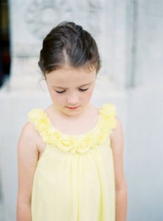 a flower girl in yellow - sweet