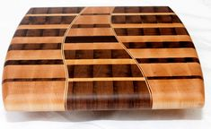 Wooden end grain cutting board by JamFineWoodworking on Etsy, $100.00