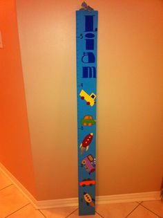 custom wooden growth chart for a boy`s room.  cars, trucks and rocket ships theme. Can be made custom by Signs By Design. Email info@signsbydesign.ca for more info.