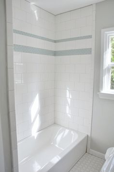Large tile in a brick pattern.  May be easier to install