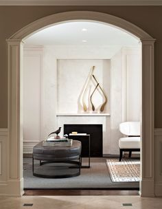 "Make A Statement With Sculptural Art | ""High-end sculptures and antiques layer soul into a space,"" says Fenwick Bonnell of Powell & Bonnell. ""In this client's living room, we showcased a collection of Jeff Goodman glass pieces on the fireplace."" A primarily neutral palette makes the art pop. 