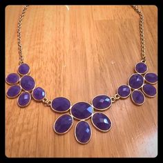 Purple statement necklace Purple multi-faceted stones with gold-colored hardware. Only worn once. Super cute! Jewelry Necklaces