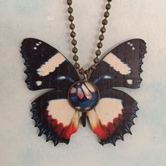 "Great Helen Wood Butterfly With Glass Cabochon Pendant created by Karen Minkel for ""Fly To Me"" at flytomeshop.etsy.com $15.95"