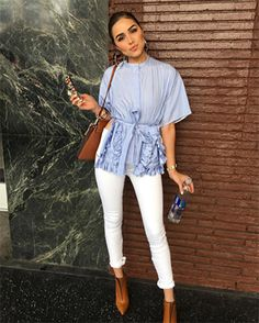 Olivia Culpo wearing a Ports 1961 Tassel Trim Shortsleeved Shirt https://api.shopstyle.com/action/apiVisitRetailer?id=512719624&pid=uid7729-3100527-84, a Chloé bag and Unravel Jeans. #style #celebstyle