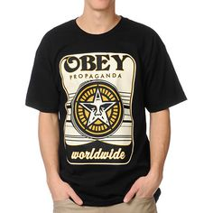 The Obey Coin Drop black tee shirt will drop mad amounts of style on your wardrobe. This standard fit all cotton guys short sleeve tee shirt features a large Obey Propaganda Worldwide Coin Drop graphic with the Andre The Giant Star logo graphic on top of