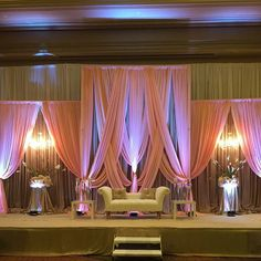 Elegant reception backdrop with warmth to Soft Pinks drapery with a modern elegant ivory loveseat. Diy Backdrop Stand, Pipe And Drape Backdrop, Fabric Backdrop, Backdrop Design, India Wedding Decorations, Backdrop Decorations, Wedding Reception Backdrop, Wedding Backdrops, Industrial Wedding Venues