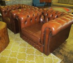 This pair of leather chesterfield chairs is perfect for sprucing up your space. Big, comfortable with just the right amount of wear they make everything around them look good. www.UptownModernAustin.com