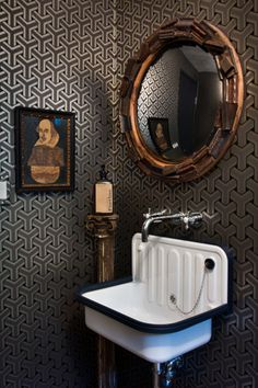 Small bathroom in a geometric wallpaper.