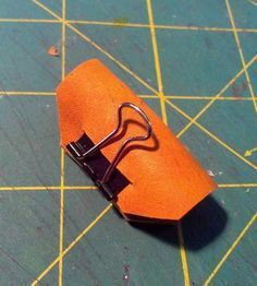 Glenda Slann on facebook recently posted a picture of an ingenious pen loop, one made of a binder clip and leather, something i've been thinking of for a long time. I just couldn't figure out how to do it. Seeing the pic I figured it out. Here are instructions on how to make your own.