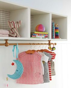 ikea bookcase with curtain rod for over changing table.  Awesome!!