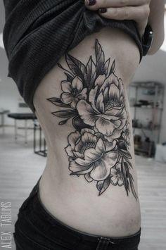 Flower Rib Tattoo - http://giantfreakintattoo.com/flower-rib-tattoo-2/