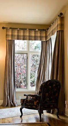 plaid window valances hung from a decorative rod with traverse rod system drapes underneath