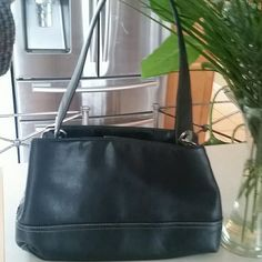 Tommy Hilfiger purse Black with silver hardware. Many compartments purse. Good clean condition. Tommy Hilfiger Bags