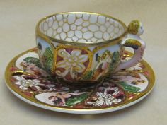 neat old ornate cup and saucer