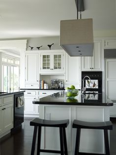 White Kitchen Black Appliances white kitchen cabinets, white carrara marble countertops, glass