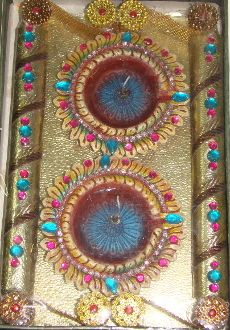 Item: Gel Diya Platter    Details: 2 Big Gel Diya Platter with golden Zari, accessories, and bead work.    Color: Earthen with multicolored bead wrok    (The actual products may look different in color, texture, and size from the digital images. Zoom images may take time to display.)    Price: INR: 420    Item #: SU55