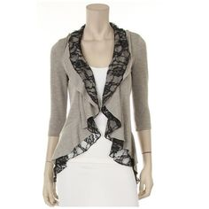 This is a hacci cardigan with lace ruffles and...