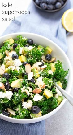 This Kale Superfoods Salad with Quinoa and Blueberries is loaded with super foods! This healthy salad is make ahead friendly for quick lunches. Goat cheese, avocado, and a honey lemon dressing bring lots of flavor to this gluten free power salad! kristineskitchenb...