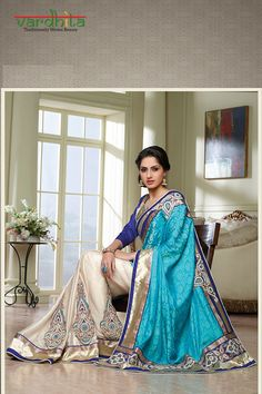 Off white & sky blue color designer saree on jacquard with chiffon fabric, this saree has resham thread zari with stone work, lace border work, two sides pipping with embroidery & stone worked patch border work. It's a wedding function wear saree with purple color dhupion blouse which can be stitched up to size 44.  http://www.vardhita.co.uk/product/white-sky-blue-color-jacquard-chiffon-saree-96-3230/