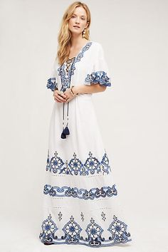 A beautifully embroidered cotton maxi complete with flounced kimono sleeves. By Tryb, the boho-inspired, city-to-seaside collection from NYC-based designers and friends Jeffrey Cayer and Sonali Singh.