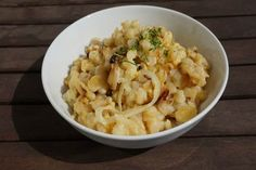 Cheesy Spaetzle [Vegan]. Spaetzle is a typical dish in Germany and Austria. This recipe is with vegan cheese and onions, but you can use it for so many other variations! I often serve them with goulash or other creamy sauces like with mushrooms. Also, it helps if you use a spaetzle maker, if you have one. You should totally try this recipe for vegan Cheesy Spaetzle because it's so good!