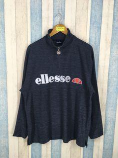 eb1f297ca91 ELLESSE Perugia Sweater Pullover Streetwear Medium Black Vintage 90s Ellesse  Italia Sports Half Zipper Ellesse Jumper. Etsy