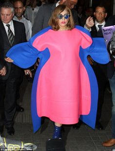 Outdone herself: Lady Gaga steps up her bizarre style another few notches by walking around Paris in this ridiculous pink and blue outfit