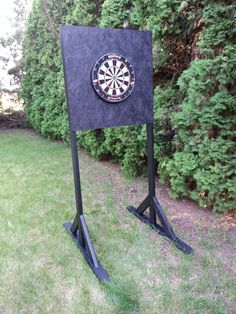 Outdoor dartboard stand. 2x4s and OSB, with 2 coats exterior latex.