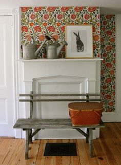 Fireplace Mantel Idea #11- Inside/Outside from Nibs blog -loved the idea of using this colorful floral fabric as a whimsical backdrop for some garden related items