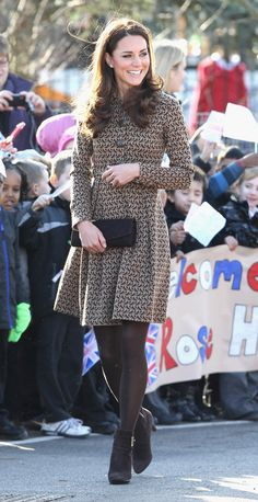 Kate looking lovely in Orla Kiely bird print dress and ankle boots