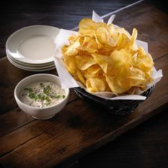 Ted's Montana Grill's Creamy Ranch Onion Dip  Hands on: 10 minutes  Total time: 10 minutes  Makes 4 1/2 cups  2 cups mayonnaise  2 cups sour cream  1 cup sliced green onions, cut into 1/8-inch pieces, reserve some for garnish  2 tablespoons ranch dressing mix  1 teaspoon Tabasco  Freshly ground black pepper, for garnish