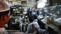Cricket on TV at a barbershop in New Delhi - in the @nytimesphoto Pictures of the Day http://nyti.ms/1Cs6trI