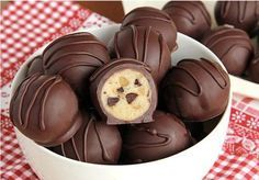 chocolate chip cookie dough truffles are so easy you're going to feel like you're cheating.These chocolate chip cookie dough truffles are so easy you're going to feel like you're cheating. Candy Recipes, Sweet Recipes, Cookie Recipes, Dessert Recipes, Cookie Dough Truffles, Chocolate Chip Cookie Dough, Chocolate Truffles, Chocolate Chips, Chocolate Deserts