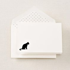 Invite someone to curl up with the news of your world by sending it on our hand engraved note with a tuxedoed cat. The matching white envelope features a white liner with black polka dots.