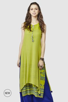 Presenting a sleeveless, classic printed kurti with a bohemian edge in double layers and little shell embellishments and pom poms.INR 2,899.00