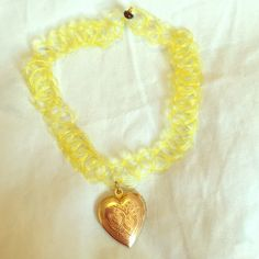 90's Choker Heart Pendant Necklace Assembled by me. Similar style to Nasty Gal, Moon Cult, Dolls Kill, etc. Vintage 90's styled yellow choker with a golden heart locket pendant. Brand new. Jewelry Necklaces
