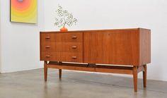 Teak Sideboard Credenza, Denmark, c. 1950s. Lovely design in teak, teak veneer and the base is solid patina oak.