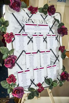 Burgundy themed wedding. Seating plan using burgundy roses.