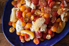 A summer salad with marinated cherry tomatoes and burrata cheese