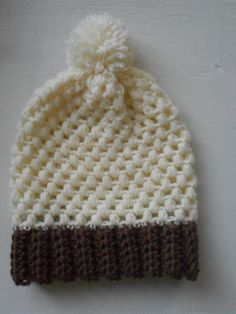 Here are two matching hats in neutral colors with fun designs! These puff stitch hats are cream colored with brown brims. Each is topped with a pompom. You can choose either the large or the small, or get both to match with a someone. Care Instructions: Machine wash cold and air dry.  Dimensions: Large: - 10 1/2 inches from the brim to the bottom of the pompom - 10 1/2 inch long brim when laid flat - 21 inches circumference at the brim - Fits the average head (21 - 25 in)   Small: -...