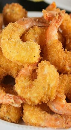 You will never believe how easy it is to make this Crispy Crunchy Fried Shrimp recipe right at home! Seasoned shrimp get lightly coated in a batter, then dipped in panko bread crumbs. Crunchy Fried Shrimp made right at home! Deep Fried Shrimp, Fried Shrimp Recipes, Breaded Shrimp, Prawn Recipes, Shrimp Dishes, Fish Dishes, Salmon Recipes, Seafood Recipes, Cooking Recipes